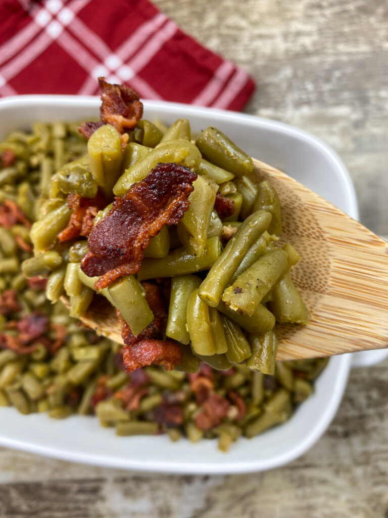 Green beans, bacon, and onion in a dish.