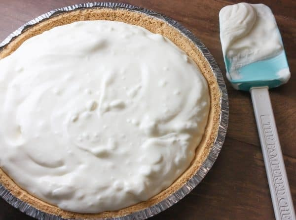 A lemon cream pie on a counter.