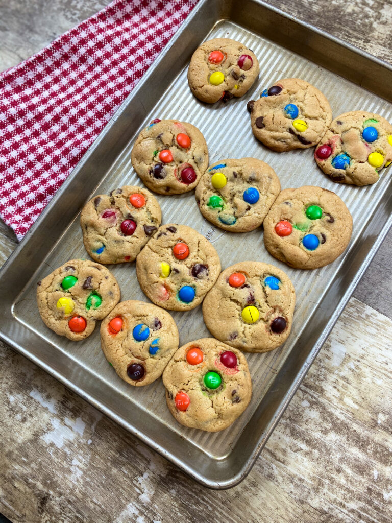 M&M cookies on a cookie sheet.