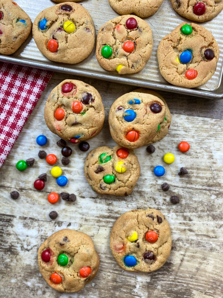 Chocolate chips M&M Cookies on a counter.