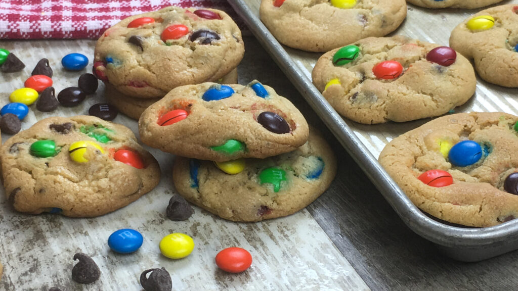 Chocolate chip M&M Cookies stacked on the counter
