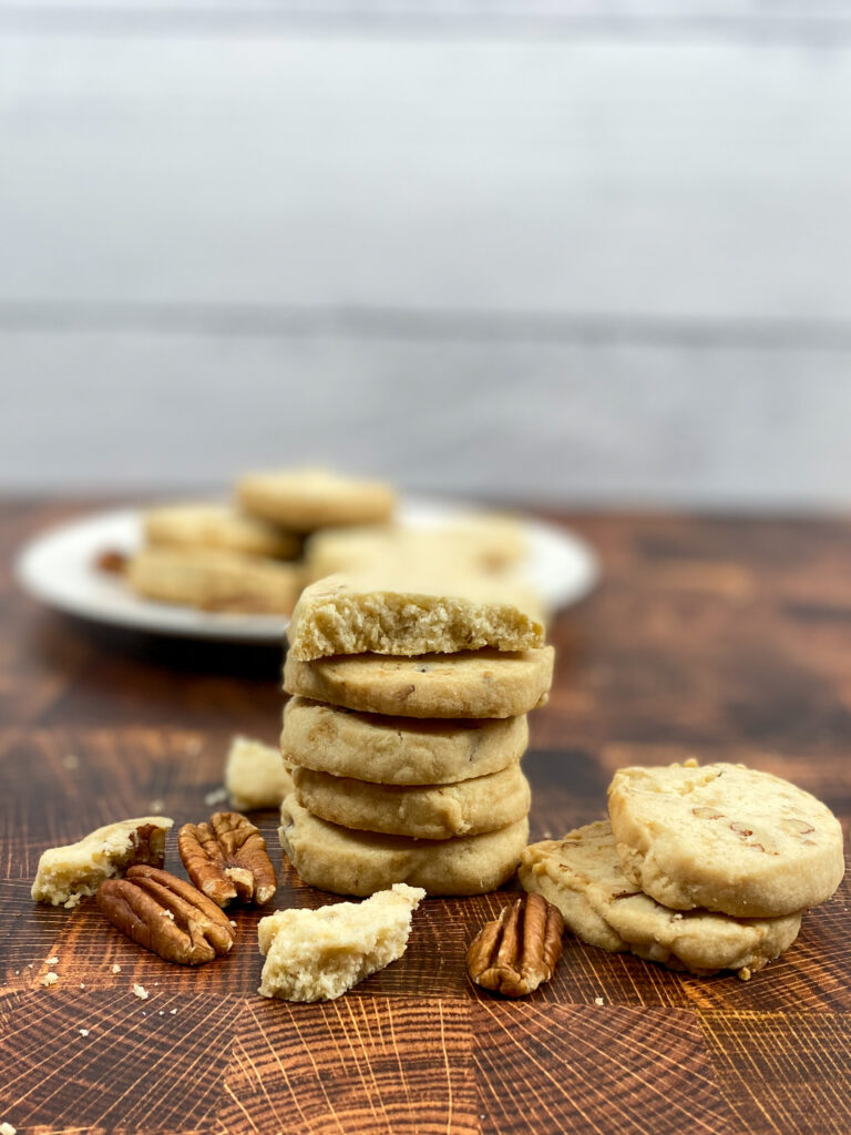 Pecan sandies stacked on top of each other.