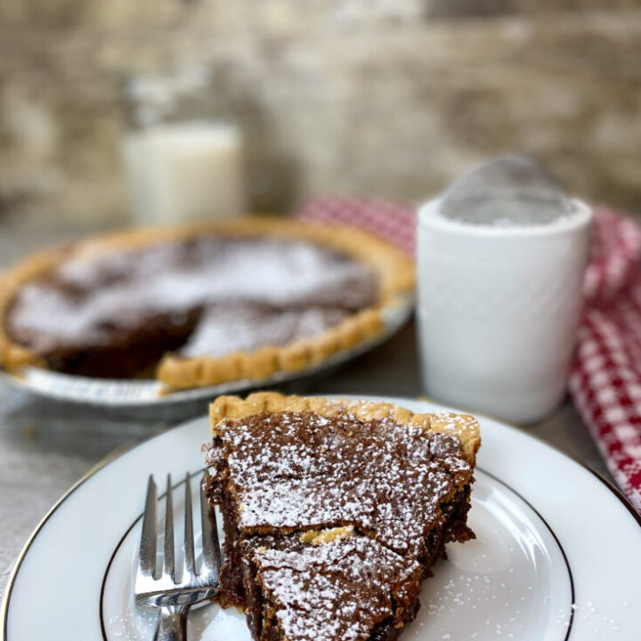 Chocolate chess pie on a plate.