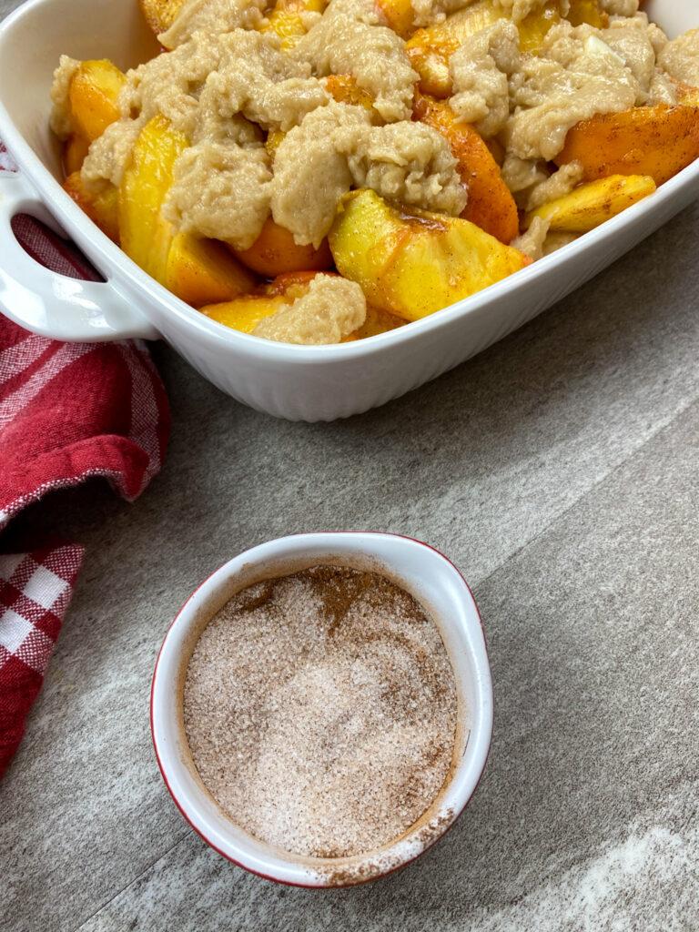 Cinnamon and sugar in a small bowl.
