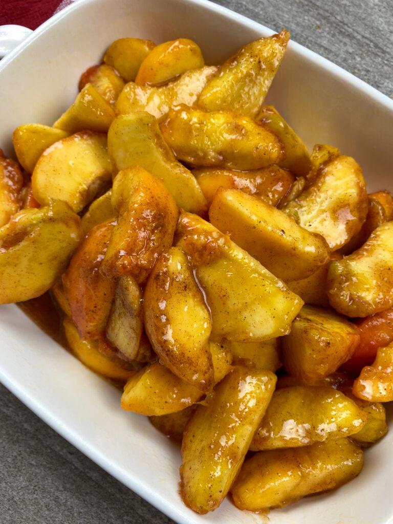 Peaches in a baking dish.