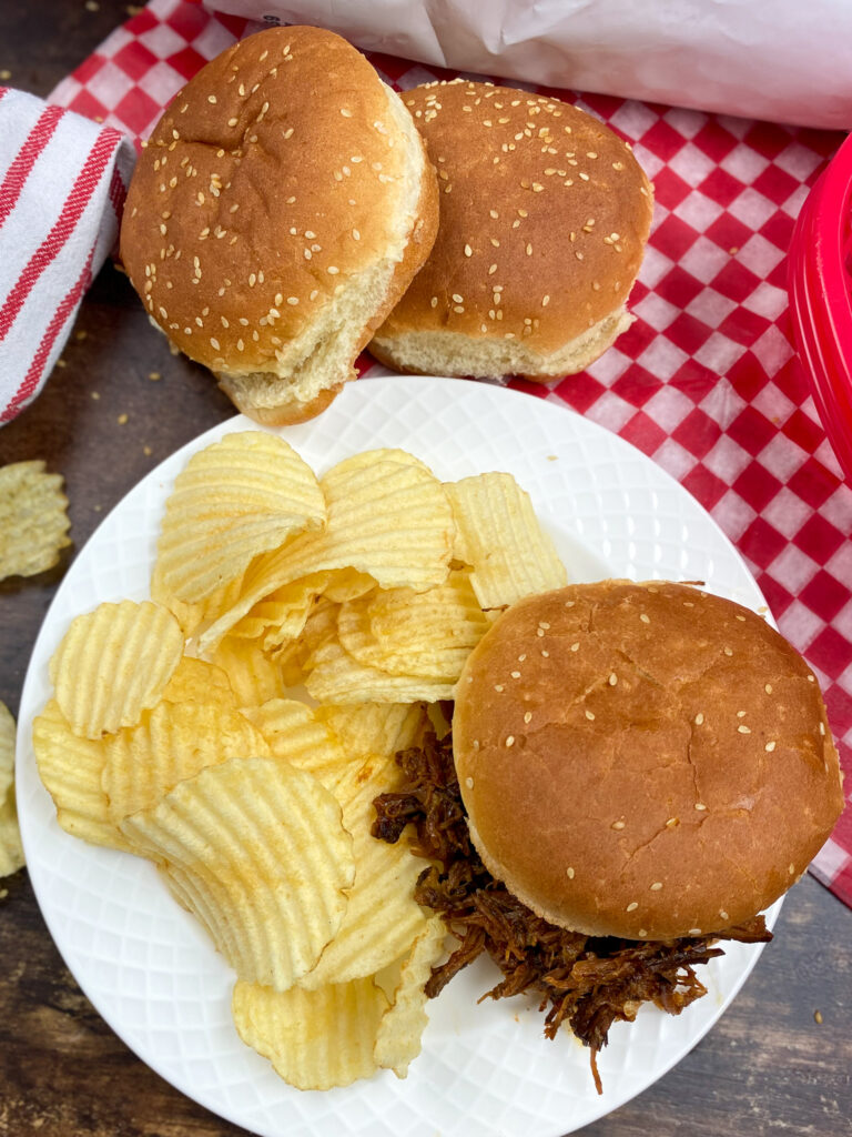 BBQ Beef on a bun with chips.