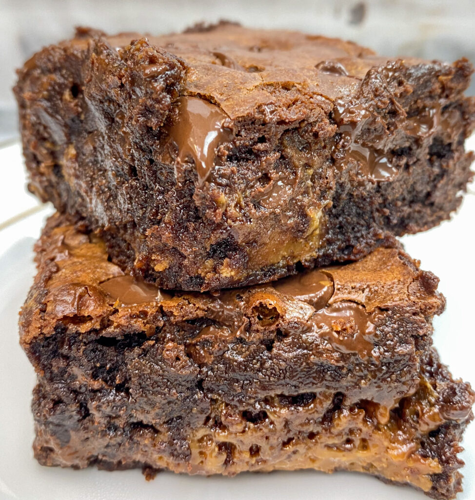 Caramel brownies stacked on top of each other.