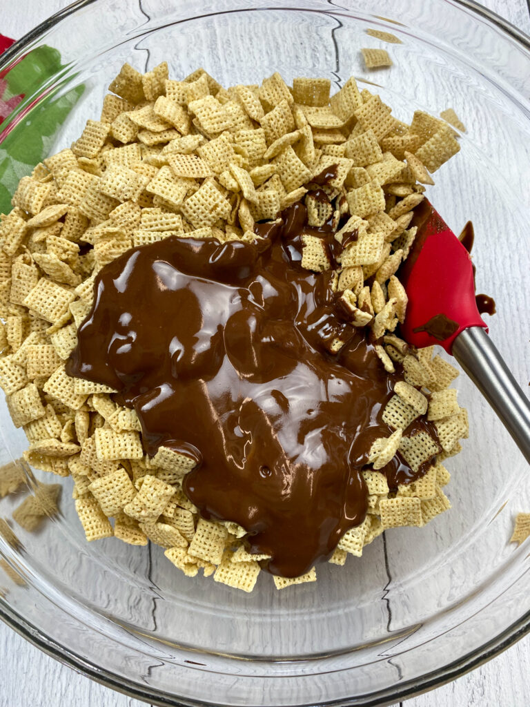 Melted chocolate on top of Chex cereal.