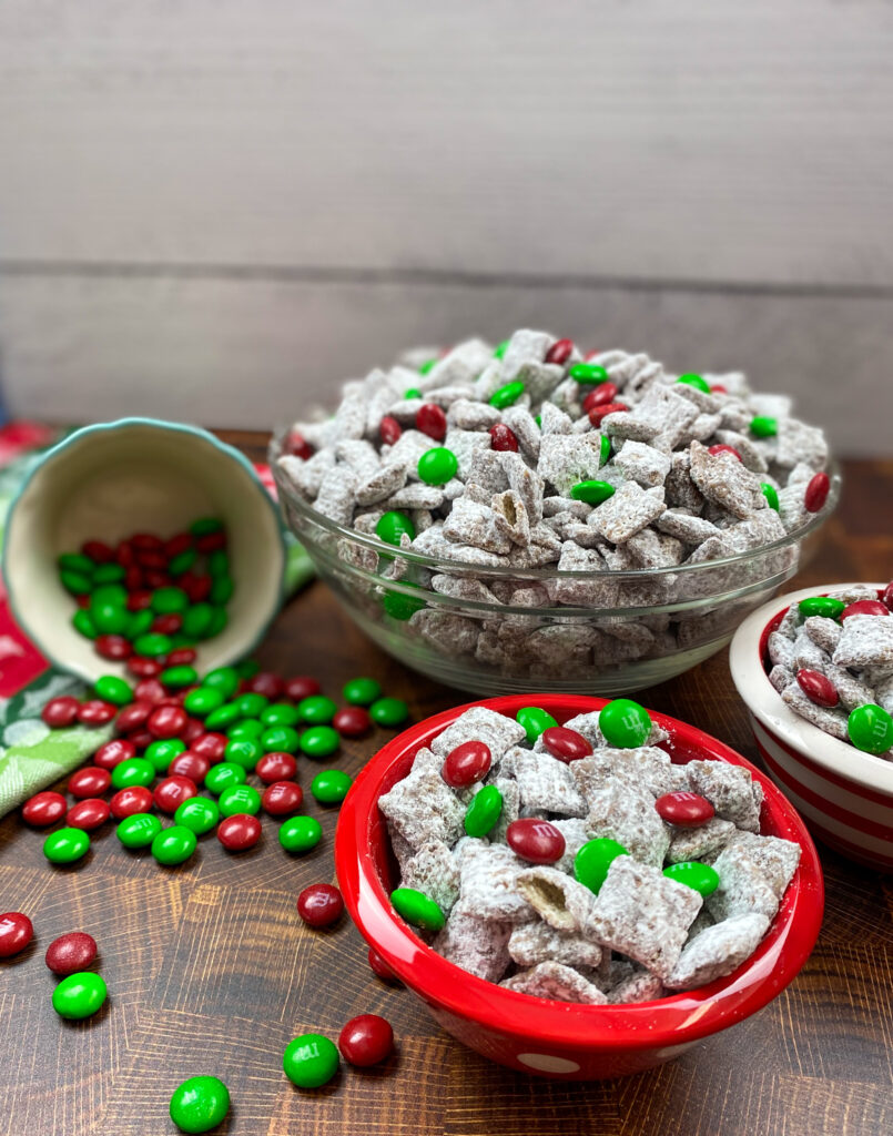 Christmas puppy chow in red and white bowl.