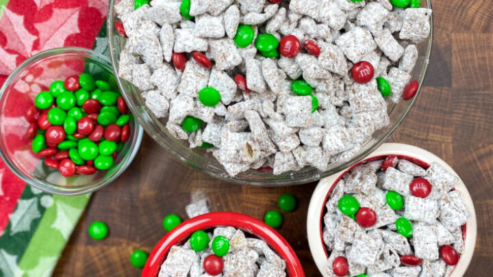 Christmas puppy chow in bowls on the counter.