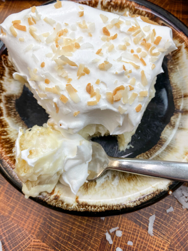 A bite of cream pie on a plate.