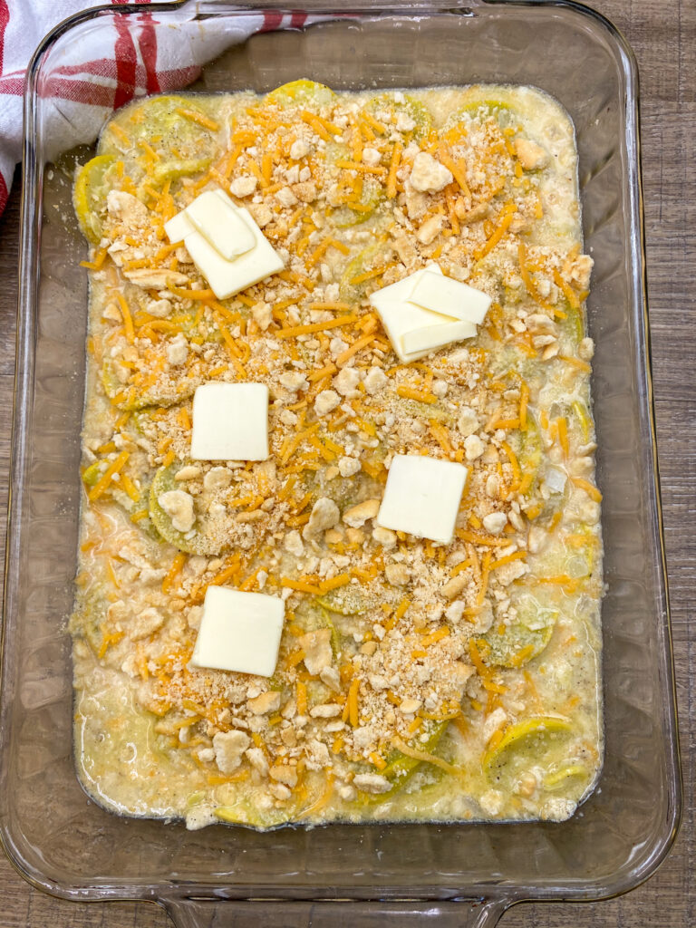 Slices of butter on top of squash casserole.