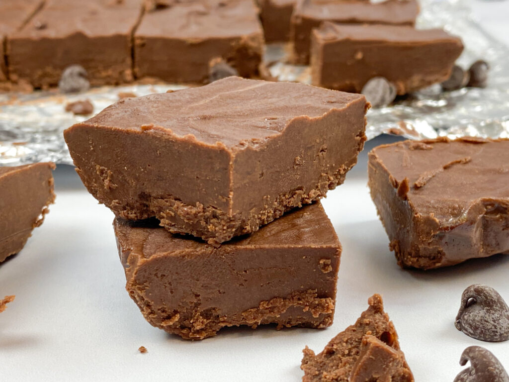Easy two ingredient fudge sliced and stacked on top of each other.