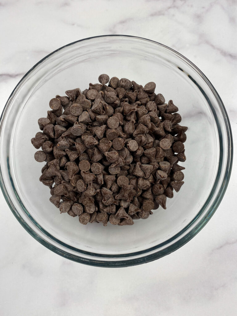 Chocolate chips in a small bowl.