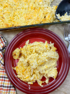 Hashbrown casserole on a red plate.