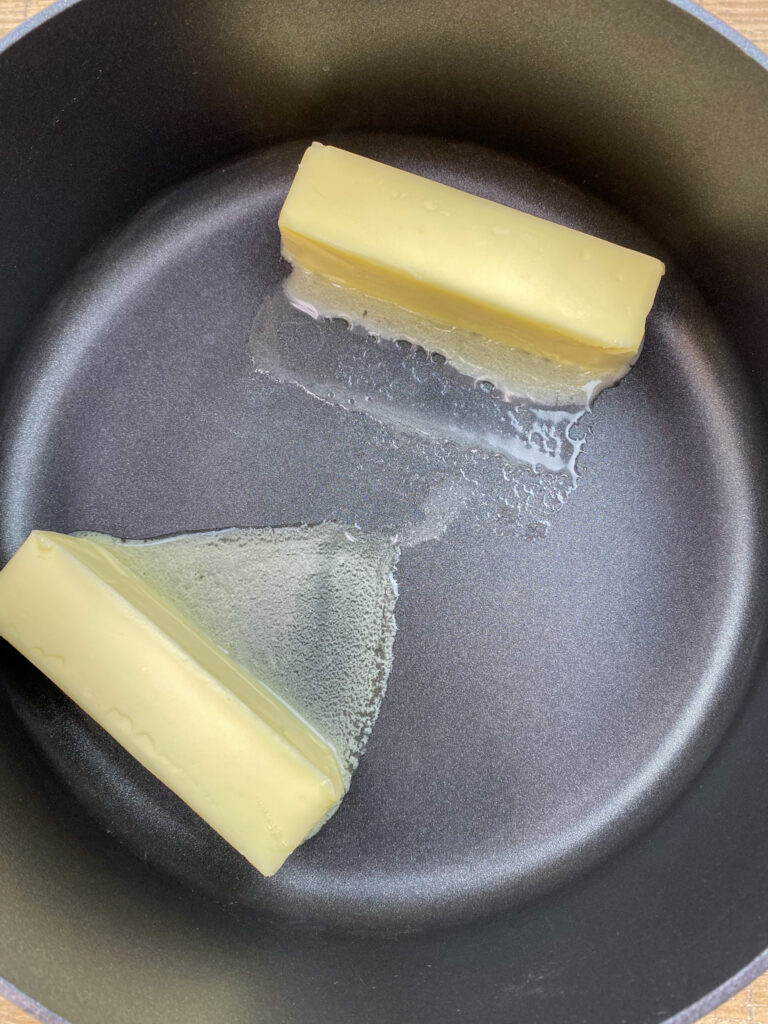 Melting butter in a saucepan.