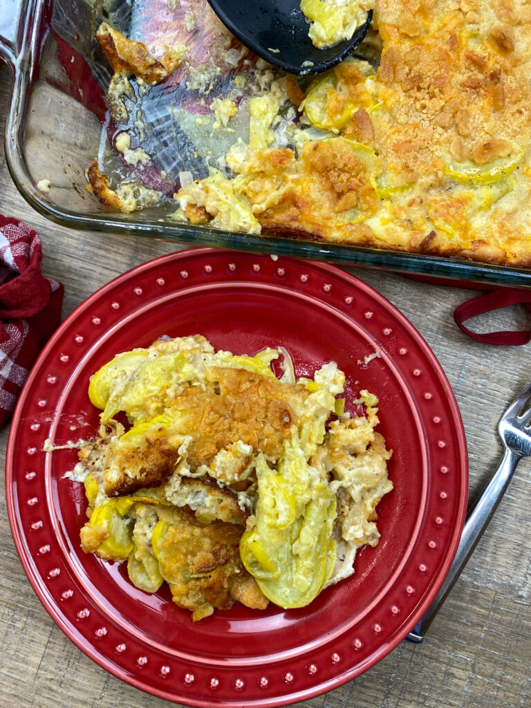 Squash casserole on a red plate.
