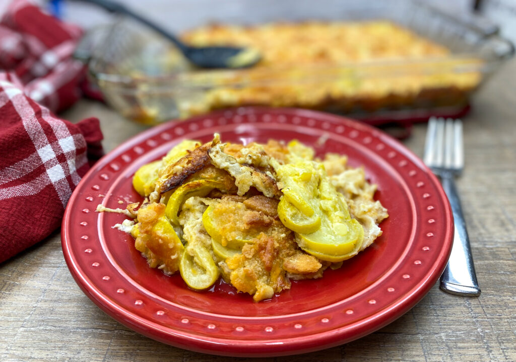 Easy squash casserole on a red plate.