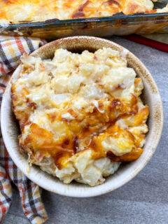 Cheesy potato casserole in a small bowl.