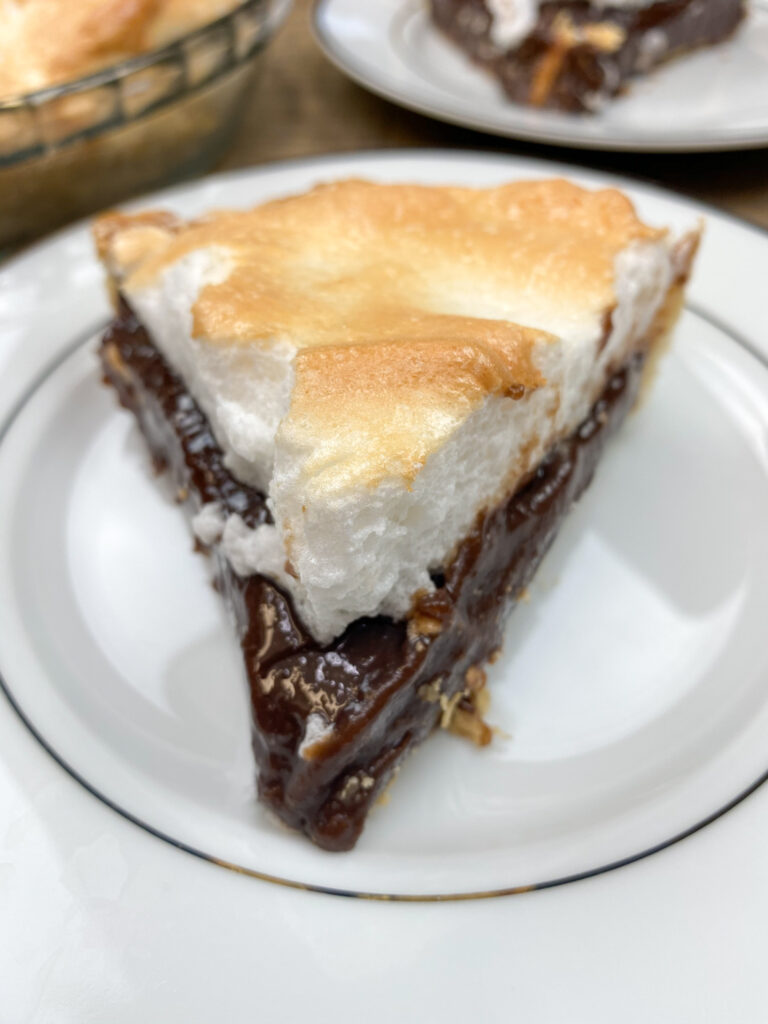 Chocolate Pie sliced and on a plate.