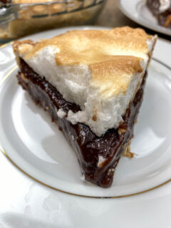 A slice of chocolate pie with meringue on a white plate.