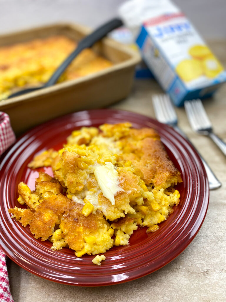 Jiffy cornbread with creamed corn on a plate.