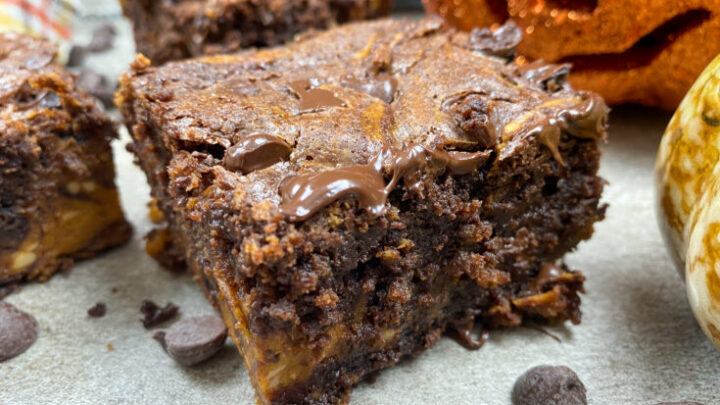 Cream cheese pumpkin swirl brownies on the counter.