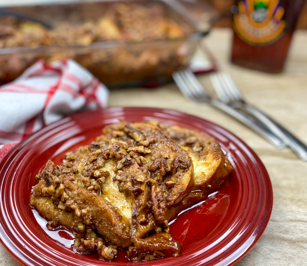 Overnight French toast casserole on a red plate.