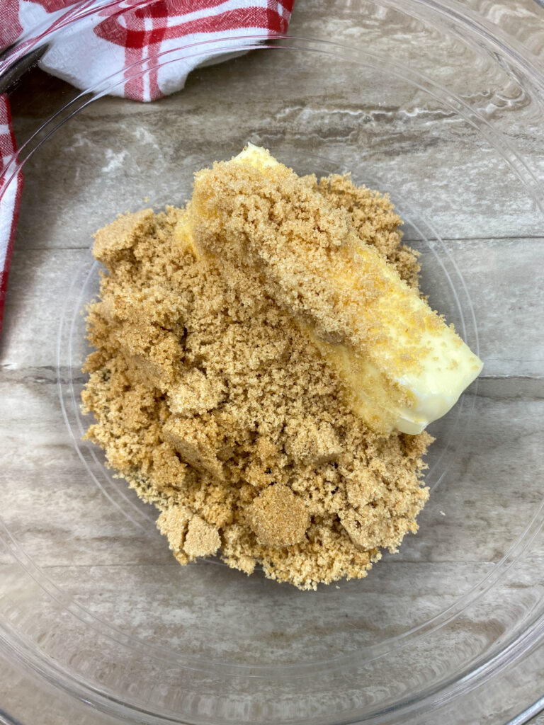 Softened butter and brown sugar in a glass bowl.