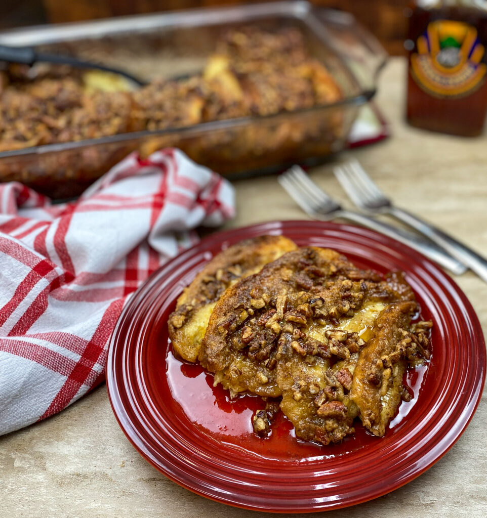 French toast casserole with pecans on a red plate.
