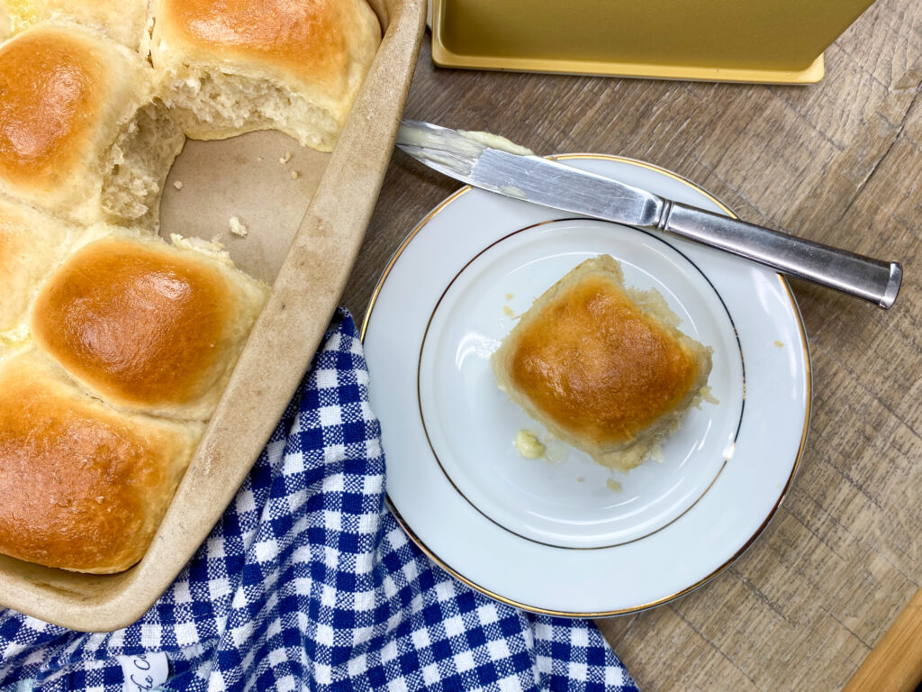 Homemade bread roll on a white plate.
