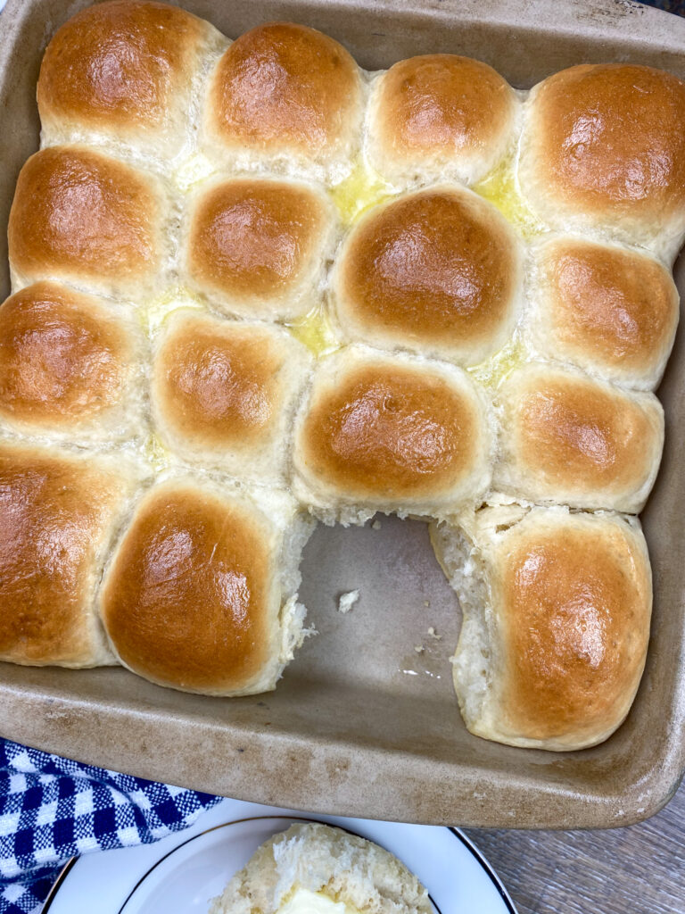 Homemade yeast rolls in a baking dish.