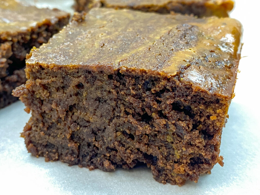 A chocolate pumpkin brownie on the counter.