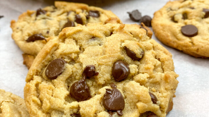 Peanut butter chocolate chip cookies on parchment paper.