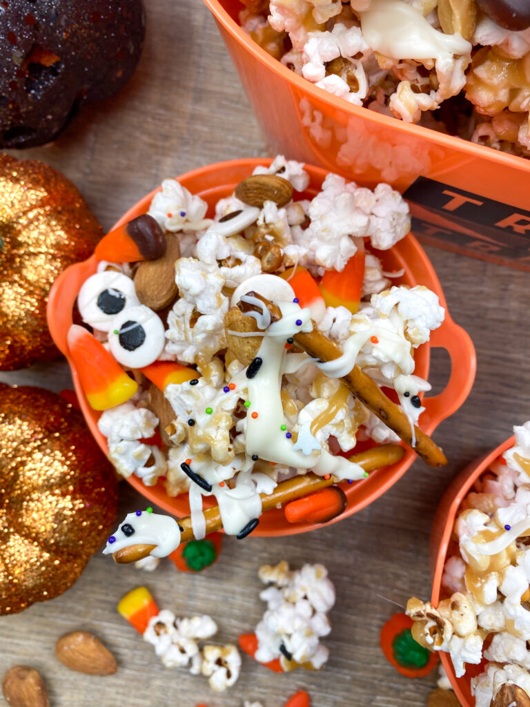 Homemade caramel popcorn, with candy corn, pretzels, and googly eyes.