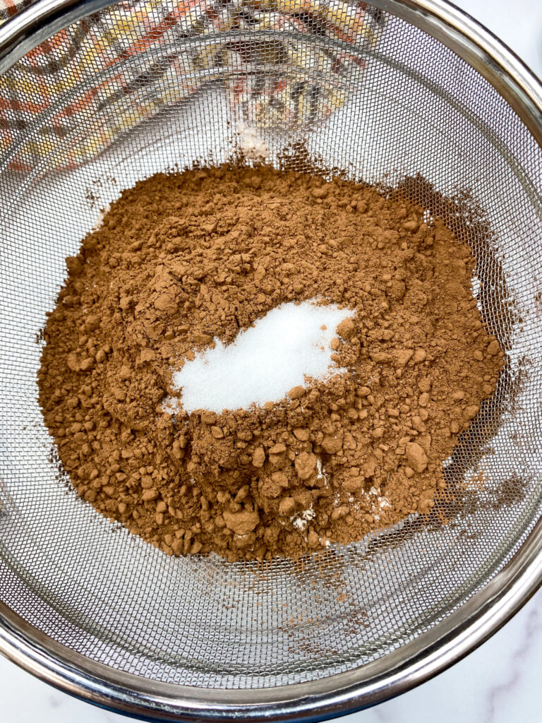 Cocoa and salt in a sifter.