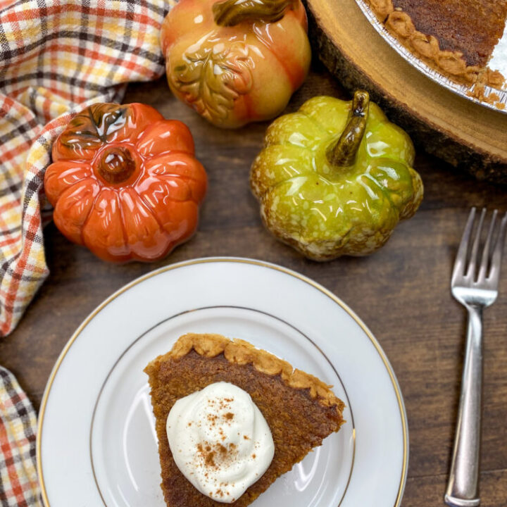 A slice of sweet potato pie on a white plate.