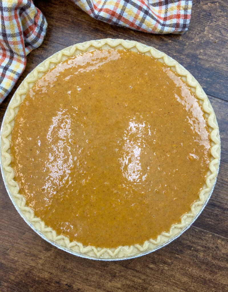 Uncooked sweet potato pie in a pie crust.