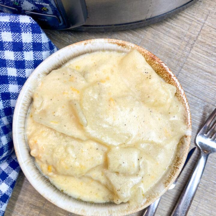 Cheesy au gratin potatoes in a bowl.