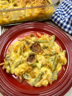 Cheesy green bean casserole on a plate.