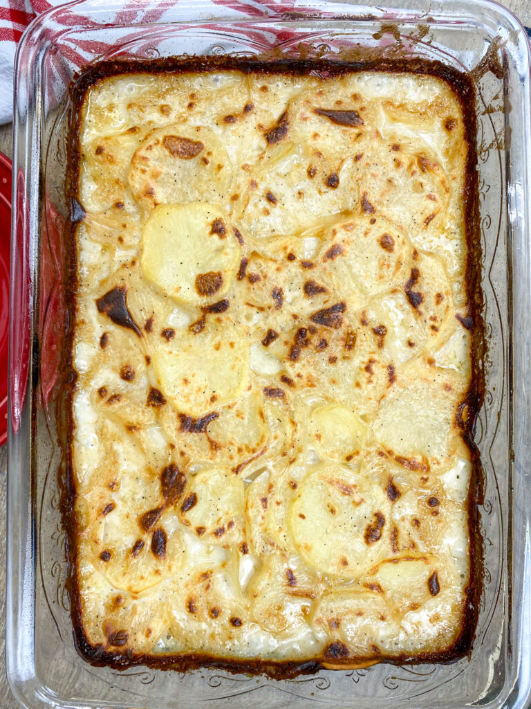 Homemade scalloped potatoes in a baking dish.