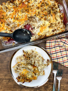 Sausage and hashbrown potato bake on a plate.