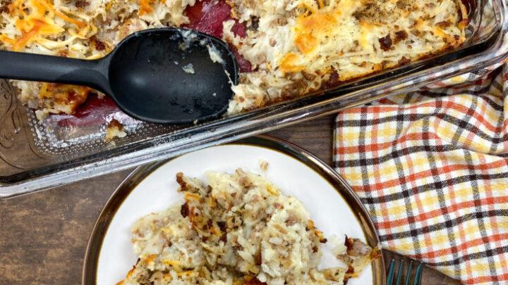 Sausage and hashbrown potato bake on a plate.
