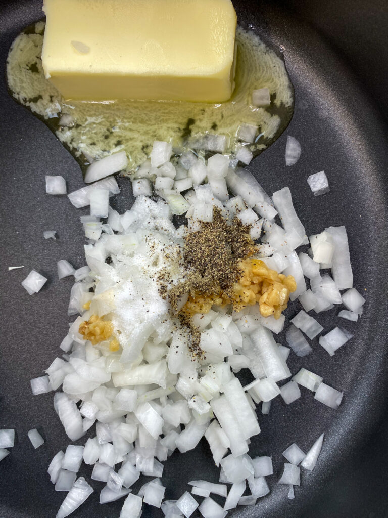 Butter, onions, and garlic in a saucepan.