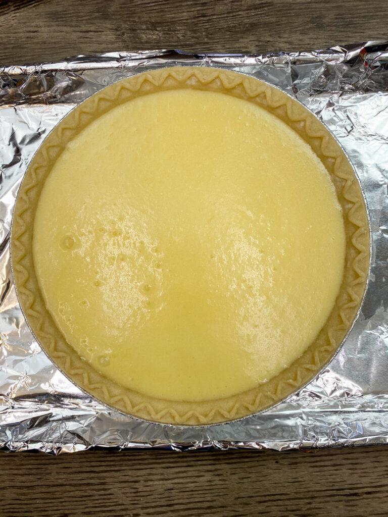 Buttermilk pie in an uncooked pie crust.