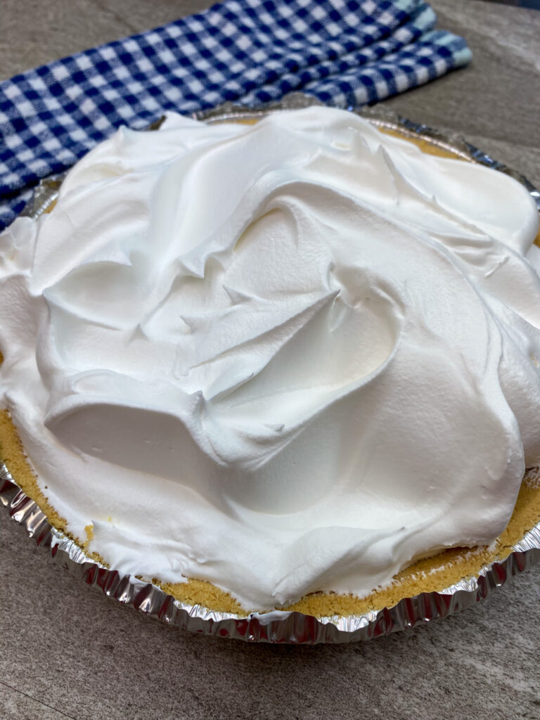 Chocolate cream pie with whipped topping.