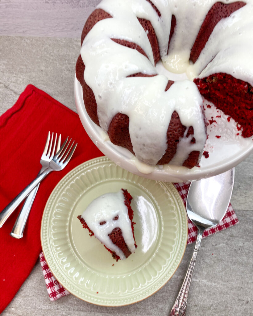 Buttermilk cream cheese frosting on top of red velvet cake.