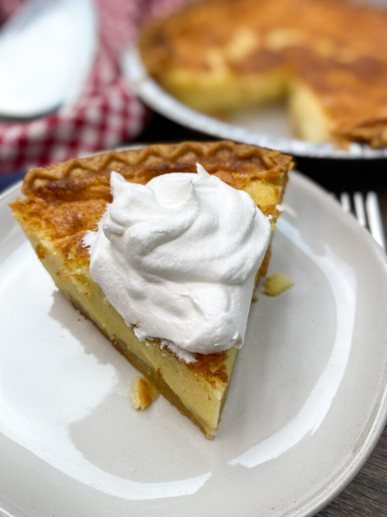 A slice of buttermilk pie on a plate.