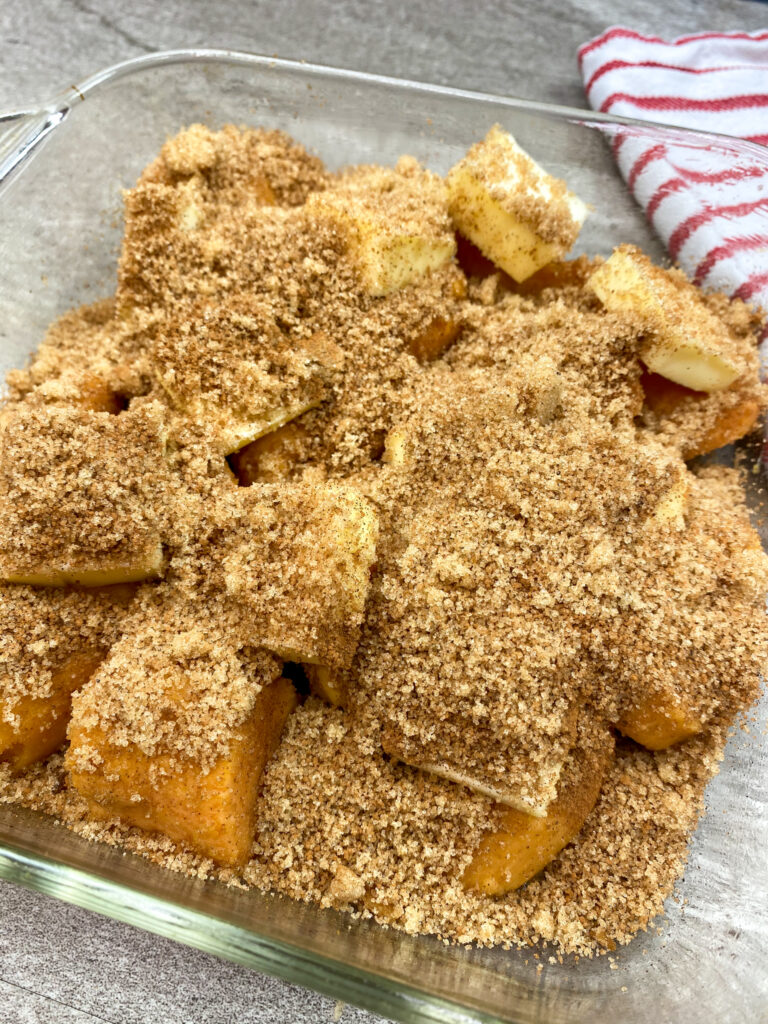 Brown sugar, cinnamon, and nutmeg sprinkled on top of butter and diced yams.