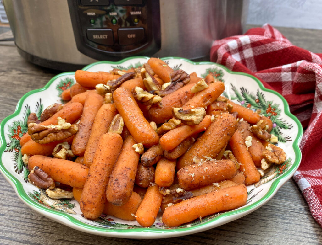 Cooked carrots with brown sugar and pecans.